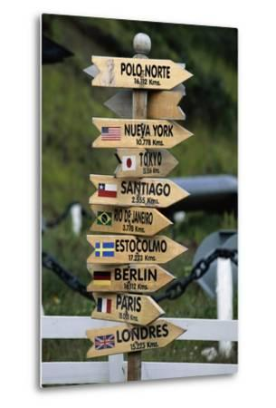 Mileage Sign Pointing Directions in Puerto Williams