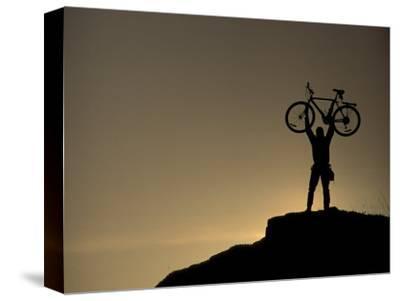 Mountain Biker on Cliffs, Turnagain Arm, Alaska, USA