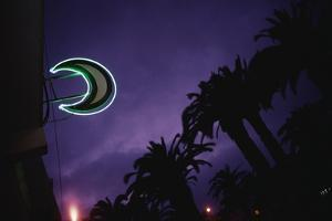 Neon Crescent Moon Above Pharmacy by Paul Souders