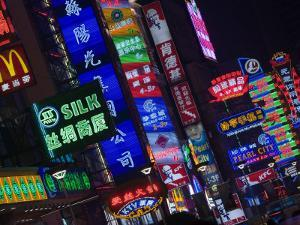 Neon Signs Line Storefronts along Nanjing Road, Shanghai, China by Paul Souders