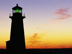 Peggy's Cove Lighthouse at Sunset by Paul Souders