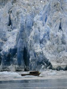 Fishing Boat Dangerously Close to a Crumbling Glacier's Edge by Paul Sutherland