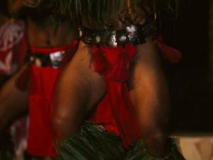 Male Traditional Polynesian Dancer in Traditional Costume by Paul Sutherland