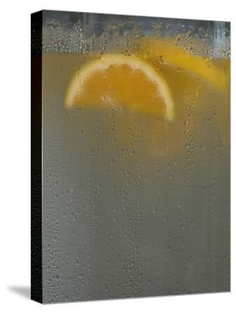 Orange Slices in a Cold Water Dispenser at a Beach Side Hotel