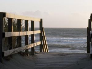 Wooden Walkway Leads to a Sunset View on a California Pacific Beach by Paul Sutherland