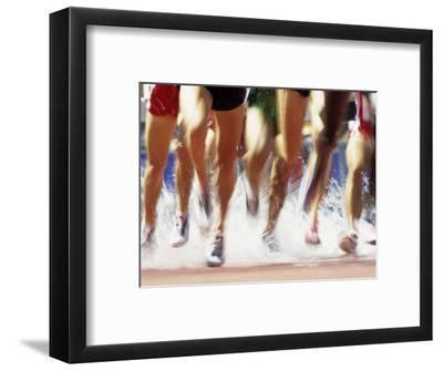 Runners Legs Splashing Through Water Jump of Track and Field Steeplechase Race, Sydney, Australia