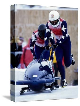 Two Man Bobsled Team Pushing Off at the Start, Lake Placid, New York, USA
