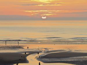 Sunset and Beach, Blackpool, England by Paul Thompson