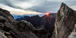 Sunrise as seen over Low's Gully, from the base of Low's peak Mount Kinabalu. Borneo by Paul Williams