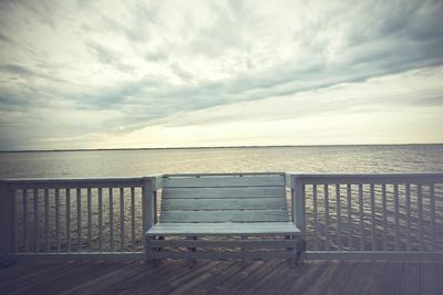 Empty Bench along the Boardwalk Overlooking the Currituck Sound in Duck in the Outer Banks of North