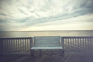 Empty Bench along the Boardwalk Overlooking the Currituck Sound in Duck in the Outer Banks of North by pdb1