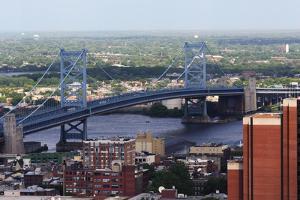 The Benjamin Franklin Bridge Crosses the Delaware River Connecting Philadelphia, Pennsylvania and C by pdb1
