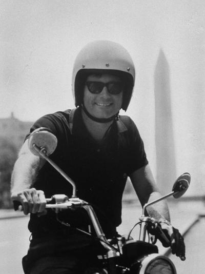 Peace Corps Director, Joseph H. Blatchford, Riding Motorcycle--Photographic Print