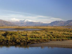Afon Glaslyn River and Glaslyn Marshes, Porthmadog, Gwynedd, North Wales, UK by Pearl Bucknall