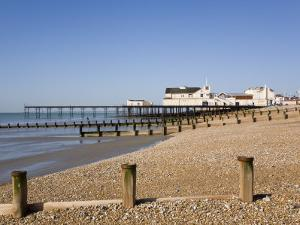 Deserted Pebble Beach at Low Tide and Pier from East Side, Bognor Regis, West Sussex, England, UK by Pearl Bucknall