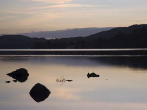 Sunset on Coniston Water in Autumn, Coniston, Lake District National Park, Cumbria, England by Pearl Bucknall