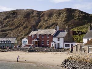 Ty Coch Inn on Beach at Porth Dinllaen Village in Bay on Lleyn Peninsula, North Wales, UK by Pearl Bucknall