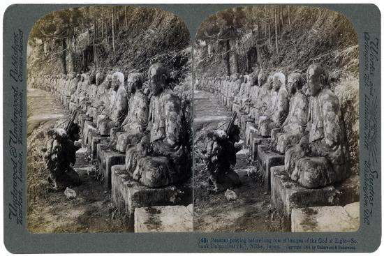 Peasant Praying before a Row of Statues of the God of Light, Daiya River, Nikko, Japan, 1904-Underwood & Underwood-Giclee Print