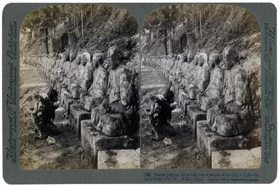 https://imgc.artprintimages.com/img/print/peasant-praying-before-a-row-of-statues-of-the-god-of-light-daiya-river-nikko-japan-1904_u-l-ptxulr0.jpg?p=0