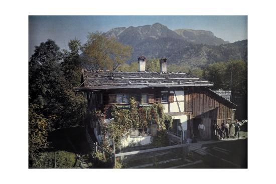 Peasants Stand Outside of their Home Next to their Garden-Hans Hildenbrand-Photographic Print