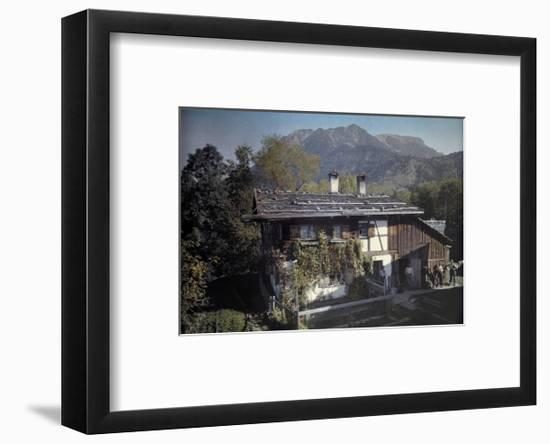Peasants Stand Outside of their Home Next to their Garden-Hans Hildenbrand-Framed Photographic Print