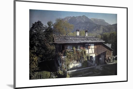 Peasants Stand Outside of their Home Next to their Garden-Hans Hildenbrand-Mounted Photographic Print