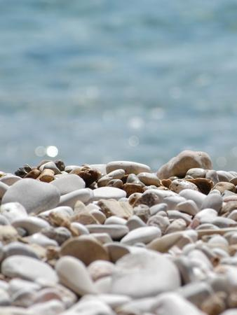 https://imgc.artprintimages.com/img/print/pebbles-on-beach_u-l-f8y0sh0.jpg?p=0