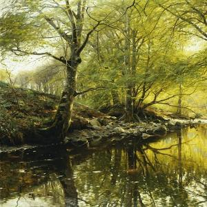 A Wooded River Landscape by Peder Mork Monsted