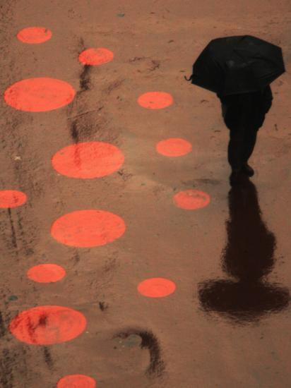 Pedestrian Makes His Way in New York's Times Square in the Rain--Photographic Print