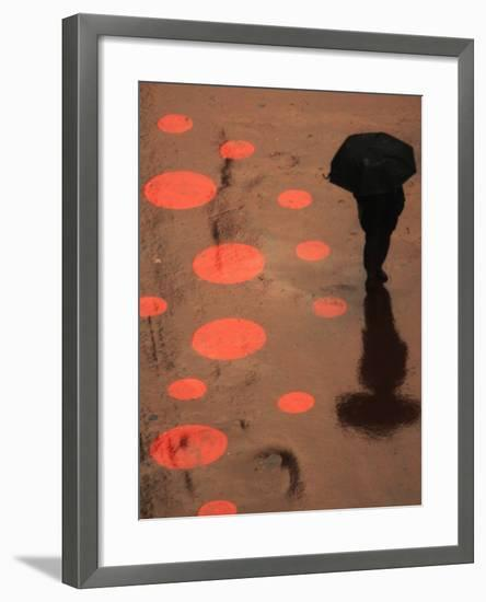 Pedestrian Makes His Way in New York's Times Square in the Rain--Framed Photographic Print
