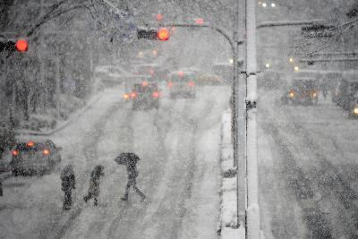 Pedestrians Cross a Large Avenue as Heavy Snow Falls in Tokyo-Franck Robichon-Photographic Print