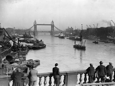 Pedestrians on London Bridge Watch Boats and Barges Being Unloaded--Photographic Print