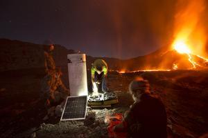 Scientists Observing Lava and Ash Plume Erupting from Fogo Volcano by Pedro Narra