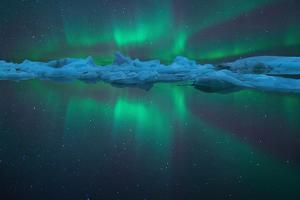 Aurora Reflection at Jokulsarlon by Peerakit JIrachetthakun