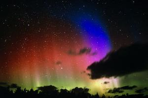 Aurora Borealis Display with Clouds by Pekka Parviainen