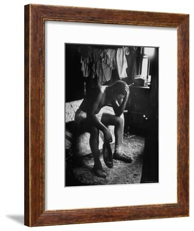 Pensive Portrait of Young African American Alone in His Room from Youth Essay-Gordon Parks-Framed Premium Photographic Print