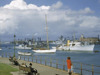 People at Gosport Hard Park Watch Ship Traffic at Naval Dockyards-B^ Anthony Stewart-Photographic Print