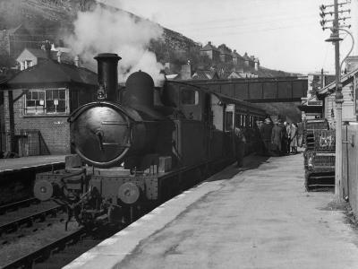 People Board a Steam Train Waiting in the Station--Photographic Print