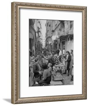 People Buying Bread in the Streets of Naples-Alfred Eisenstaedt-Framed Premium Photographic Print