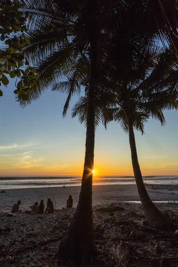 People by Palm Trees at Sunset on Playa Hermosa Beach, Santa Teresa, Costa Rica-Rob Francis-Photographic Print