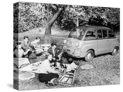 People Enjoying a Picnic Beside a 1956 Fiat 600 Multipla, (C1956)