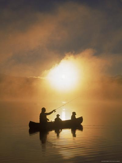 People Fishing from Canoe at Sunset-Bob Winsett-Photographic Print