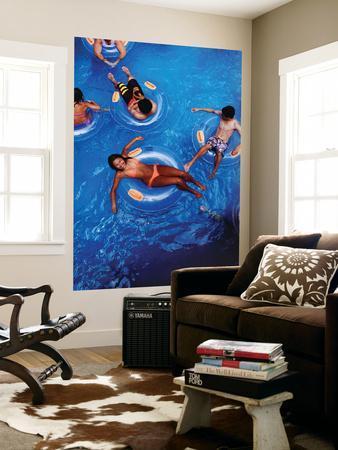 https://imgc.artprintimages.com/img/print/people-floating-in-pool-on-rubber-rings_u-l-pfgxn80.jpg?p=0