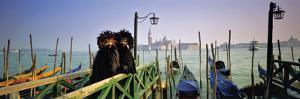 People in carnival costume at dock, Venice, Veneto, Italy