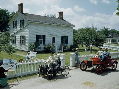 People in Costume Park Antique Ford Cars Near Henry Ford's Birthplace-Andrew Brown-Photographic Print