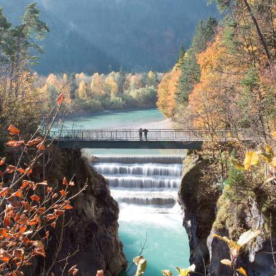 People on a Bridge Over the River Lech and Lechfall, a Man Made Fall-Alex Saberi-Photographic Print