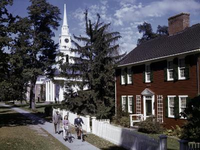 People Pass Typical New England Colonial-Style Clapboard House-B^ Anthony Stewart-Photographic Print