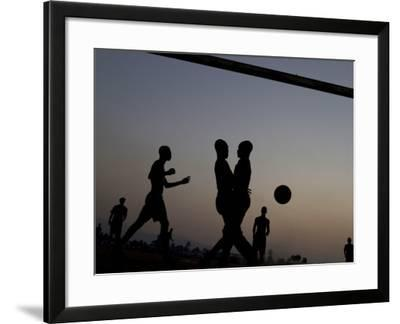 People Play Soccer at a Camp Set Up for Earthquake Survivors Left Homeless in Port-Au-Prince--Framed Photographic Print