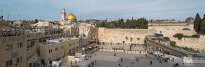 People praying at at Western Wall with Dome of the Rock and Al-Aqsa Mosque in the background, Ol...