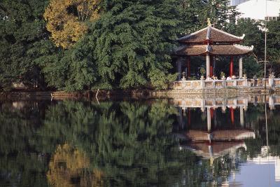 People Resting under Pagoda on Hoan Kiem Lake Shore-Design Pics Inc-Photographic Print